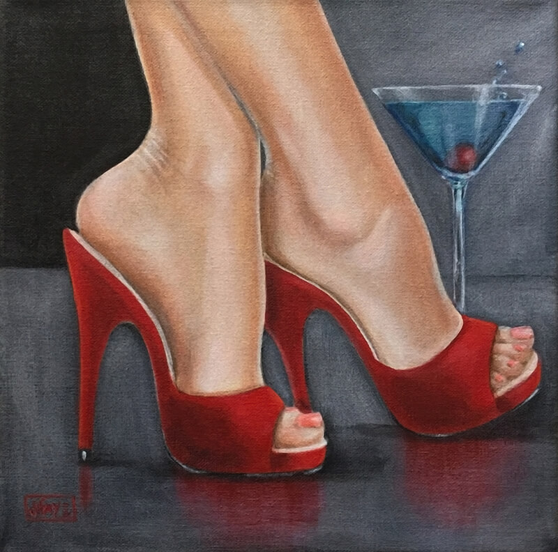 feet with red shoes and a martini glass